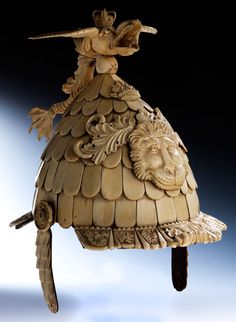 Parade helmet in ivory Total height: 38 cm. 19th Century.  Descended in the collection tradition as a parade helmet of George III of England...