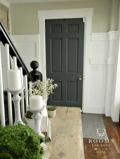 painted front door color - Graphite by: Annie Sloan, wall color Hazy Skies by: Sherwin Williams
