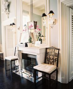 love the long mirror over the mantle and use of black