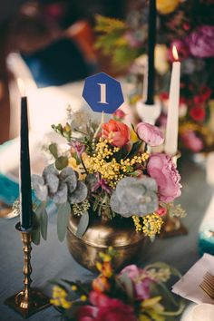 heptagon table numbers, photo by JBM Wedding Photography, styling by Tinsel & Twine http://ruffledblog.com/bold-geometric-wedding-inspiration #weddingideas #tablenumbers #centerpieces