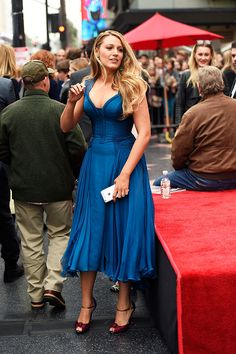 Actress Blake Lively in Atelier Versace and Christian Louboutin attends a ceremony honoring Ryan Reynolds with a star on the Hollywood Walk of Fame on December 15 2016 in Hollywood California