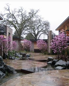 Sprial stone work on the ground plane juxtaposed with rough hewn basalt verticals, water and those blooming magnolias made the rainy trek so worth it. Kew Gardens, Small Gardens, Outdoor Gardens, Indoor Garden, Outdoor Rooms, Outdoor Living, Landscape Architecture, Landscape Design, Porches