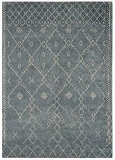 Amira AM002 Blue Moroccan Rug... A Moroccan style design based on nomadic North African concepts on a deep, dense all-wool pile. The blue is neutral and subdued with hints of grey, a sort of light petrol blue.