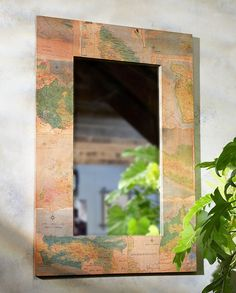 Real recycled maps make up the frame of this unique mirror handmade in Indonesia. Bring a sense of Wanderlust to any room ~ Fair Trade + Sustainable Home Decor