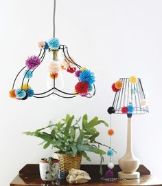 Completely change the look of your lampshades with brightly-coloured pompoms // Homemaker Issue 44 // Credit: Pompomania by Christine Leech (£10, Quadrille).