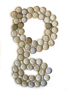 Letter G made from beer bottle caps