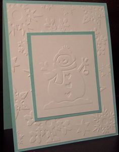 Winter card with 2 different embossing folders, snowman and snowflakes