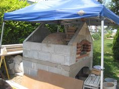 Outdoor Wood Fired Pizza Oven | Finally the oven is fired and the first pizza sizzles on the hot floor ...