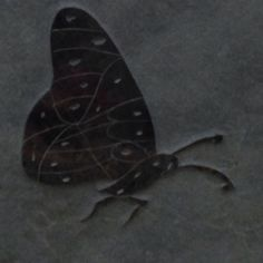 Detail of a Butterfly on a headstone....