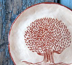 Ceramic plate with tree. This ceramic plate hand built of white clay, decorated with terracotta, fired about 1050 C,then glazed with transparent glaze and fired again.  If you want another size or quantity,please contact me. Lead free. Non toxic.  Measurement:  17 cm in diameter. 7  Ready to ship in 2-3 weeks.  All of my items come well packaged to prevent any damage.  Air delivery from Russia with tracking & insurance. Please allow 2-4 weeks for delivery.  Feel free to contact me with an...