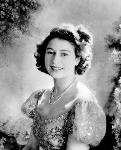 p An official Cecil Beaton portrait shows Princess Elizabeth smiling in  Buckingham Palace. 91746a57c1