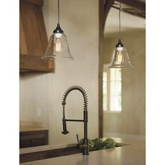 """Glass Pendant Shade Adapter for Hardwire Light, $69  Dimensions: Hardwire Adapter: 12'L Black Cloth Cord and 6"""" Diameter Canopy Construction: Adapter: Made of metal and plastic. Shades: Made of glass. Lighting: Uses 75W max bulb. Country of Origin: China"""