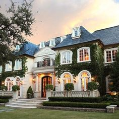 A French inspired mansion what a phenomenal house its just gorgeous yes I think its out with Tuscany Style and its in with French style I think that's the next big trend just my opinion..yes french country