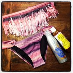 All you need to make it through the day, ladies! @lspaceswim #FringeBikini, a little #MauiBabe and some sunscreen! In #Hobie #SurfShop and Online at www.hobiesurfshop.com! #GetToTheBeach #Surf #Ocean #Sand #Fun #Lspace #bikini #bronze #fringe #california #sanclemente #lagunabeach #danapoint #coronadelmar