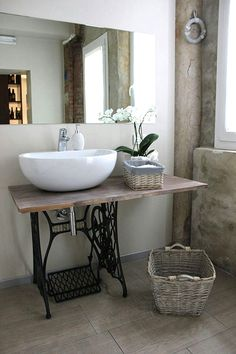 Love the old singer sewing machine table and WHITE sink. I'd prefer a smaller sink though!! Perfect colors!