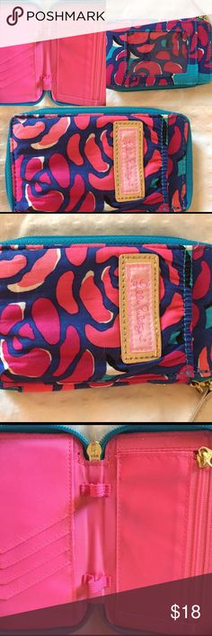 Lilly Pulitzer Wallet Lilly Pulitzer Wallet, pre loved. Only sign of wear is on front insignia shows some little smudging (pictured). Lilly Pulitzer Bags Wallets