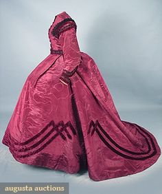 GARNET SILK TRAINED RECEPTION GOWN, c. 1864 April 2006 Vintage Clothing & Textile Auction New Hope, PA 3-piece moire faille trimmed w/ black silk lace & bands of garnet velvet on skirt & sleeve, bodice w/ 7 original velvet covered buttons, all original linings, separate 1.75 wide lace trimmed belt, B 36, W 25, front skirt L 42, back skirt L 64,t/w black Chantilly lace tippet 17 x 152, (2 seams on L sleeve unstitched) excellent.