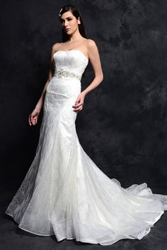 STYLE: BL084          This gorgeous Lace gown has been lined with Royal Duchess Satin and made strapless with a sweetheart neckline. The natural waist has been crystallized with beading and rhinestones and the fitted A-line skirt is made with a chapel length train. Available in White or Ivory.