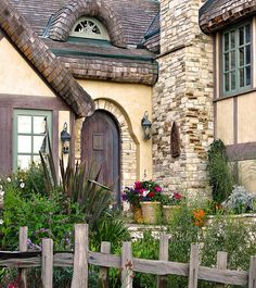 carmel-by-the-sea fairytale houses:  round door, roof, garden, stake fence.  hugh comstock