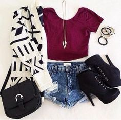 Cute outfit. Cropped top, high-waisted shorts, cardigan and ankle boots.