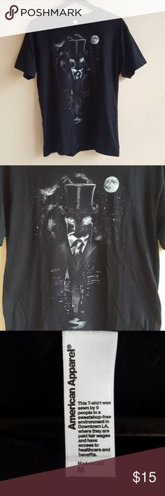 """Starry Night City Street Cat Black T-Shirt American Apparel black short sleeve tee with image of dapper black cat dressed in a suit with a monocle, top hat, and cigar in a starry cityscape with moon. Mens size medium.  Length Shoulder to Hem: 27"""" Pit to Pit: 19"""" American Apparel Shirts Tees - Short Sleeve"""