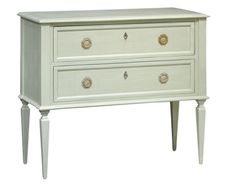 A fresh take on traditional english style. This creamy neutral chest has two ample drawers for storage and antique brass hardware with skeleton key holes. Heig