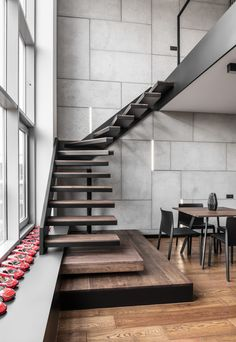 Metal and wood blend nicely in the design of floating stairs, adding a subtle industrial touch to the space