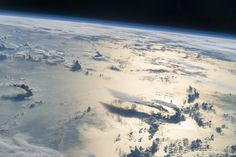Picture of the day for November 16 2016 by Nasa Flying over the Philippine Sea an astronaut looked toward the horizon from the International Space Station and shot this photograph of three-dimensional clouds the thin blue envelope of the atmosphere and the blackness of space. The late afternoon sunlight brightens a broad swath of the sea surface on the right side of the image.
