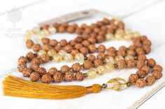 This long mala beads is made with rudraksha seeds and citrine gemstones. Each bead is individually hand knotted. Prayer mala or meditation beads are used by Buddhists and Hindu around the world. In Tibet, Nepal and India they are used for meditation, counting mantras, and