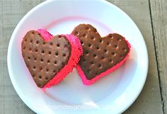 Easy Valentine treat -- cut ice cream sandwiches with a heart shaped cookie cutter and roll in pink sprinkles