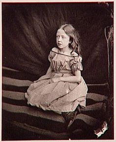 "Lewis Carroll, Florence ""Flo"" Terry seated on a carpet, 1865"