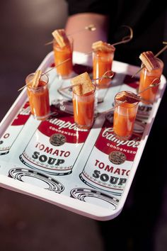 Mini shot glasses of tomato bisque with miniature grilled cheese sandwiches