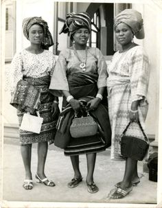 Nigerian ladies wearing traditional Iro and Buba. Judging by the length of the short wrapped buba, shoes and handbags this picture is from 1960's. Reminds me of pics of my mum and her sisters..