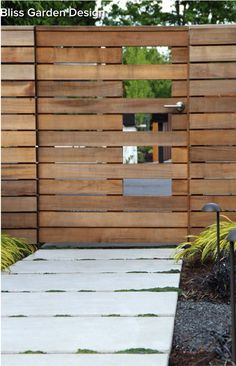 Horizontal board fence is both modern and warm. A column of artful gaps breaks it up.