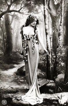 Portrait c.1910 by Reutlinger. photo, figure, woman, front, 3/4 view, reaching, vintage, hair, looking down, floral, hair, fairy tale, woodland,