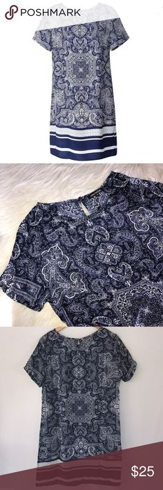 "Navy White Bandana Paisley Print Shift Dress Light and breezy navy and white bandana paisley print dress. Striped band at hem.  New with tags.  Soft fabric with silky feel short sleeves.  Pit to pit laying flat 19.5"", length 35"".  100% poly OMONSiM Dresses Midi"