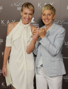 Pin for Later: Ellen DeGeneres and Portia de Rossi Have the Look of Love Down Ellen and Portia showed off their wedding bands at a July 2010 event in LA. Ellen And Portia Wedding, Ellen Degeneres And Wife, Portia Degeneres, The Ellen Show, Ellen Degeneress, Portia De Rossi, Lgbt Wedding, Wedding Bands, Lgbt Love