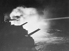 HMS Mauritius firing on German targets in Audierne Bay France 23 August 1944.