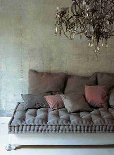 vintage chic glam crystal chandelier victorian modern boho gypsy -- tufted deep bench with shabby chic legs and whitewash paint -- gray pink rose pillows --- industrial rustic cottage
