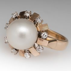 This lovely vintage pearl ring features a halo of alternating diamonds and brushed finish gold bars. This ring has a great presence on the finger and is in very good condition and is crafted of yellow gold. Pearl Jewelry, Diamond Jewelry, Antique Jewelry, Vintage Jewelry, Pearl Rings, Rings For Her, Pearl Set, Vintage Pearls, Halo Diamond