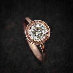 Halo Engagement Ring, Moissanite Ring, Rose Gold Engagement Ring, Rose Gold by onegarnetgirl on Etsy https://www.etsy.com/listing/209126781/halo-engagement-ring-moissanite-ring