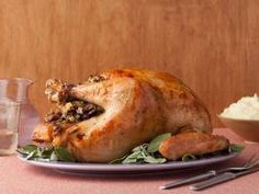 Alton's Turkey with Stuffing : See Alton's secrets to cooking perfect stuffing inside your turkey.
