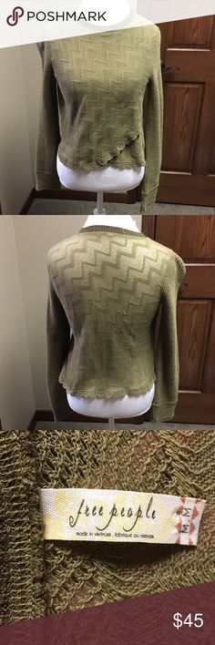 Free People green sweater Adorable green Free People sweater.  It has a pattern all over and has some ruffles along the edge. The sleeves have larger holes in them. There's are some snags on the back but other than that it's in good condition.   🌸BUNDLE AND SAVE  🌸NO TRADES 🌸REASONABLE OFFERS CONSIDERED  🌸FEEL FREE TO ASK QUESTIONS 🌸I DO NOT MODEL Free People Sweaters Crew & Scoop Necks