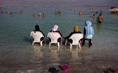 Gosh, they sure know how to hhave a good time!!!  ........        Muslims and other tourists hang out at the resort of Neve Zohar in the southern part of the Dead Sea