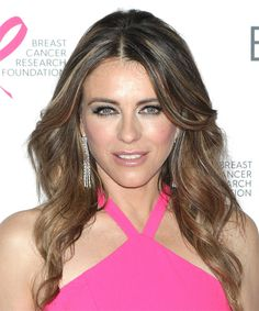 Elizabeth Hurley Long Wavy Casual Hairstyle with Side Swept Bangs - Brunette Hair Color with Dark Blonde Highlights - Lobfrisuren Oval Face Shapes, Oval Faces, Elizabeth Hurley, Casual Hairstyles, Wavy Hairstyles, Dark Blonde Highlights, Fly Away Hair, Fair Complexion, Side Swept Bangs