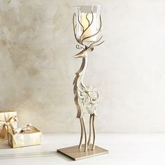 When it's time to decorate for your next candlelit Christmas soiree, let our reindeer do the heavy lifting. Crafted by hand of mango wood with rust-resistant iron limbs and antlers, this one-of-a-kind reindeer will proudly protect any 3x6 pillar. A Pier 1 exclusive.