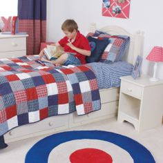 We love the retro Mod vibes of the Target rug - looks great in this red, white and blue colour scheme.  http://www.designedforkids.co.uk/collections/rugs/products/target-circle-rug