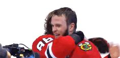 Kane and Toews hugging after winning the cup again