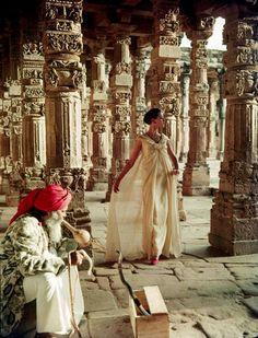 Norman Parkinson, The pillars of Quwat-Ul-Islam Mosque. Ball gown by Christian Dior, Delhi, Vogue, November 1956