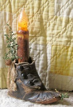 antique child's shoe with candle